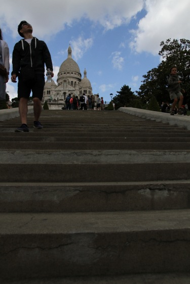 Climbing the stairs up to Sacré Cœur
